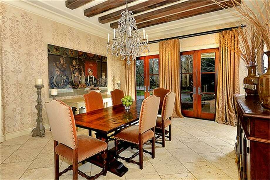 This dining room has generous wall space, as well as double doors to front of home. Photo: Better Homes And Gardens Real Estate Gary Greene