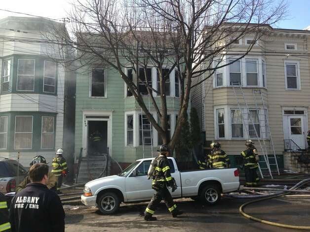 Albany Fire Department continues to work on a fire at 268 Sheridan Ave. on Tuesday, Feb. 26, 2013. (Skip Dickstein/Times Union)