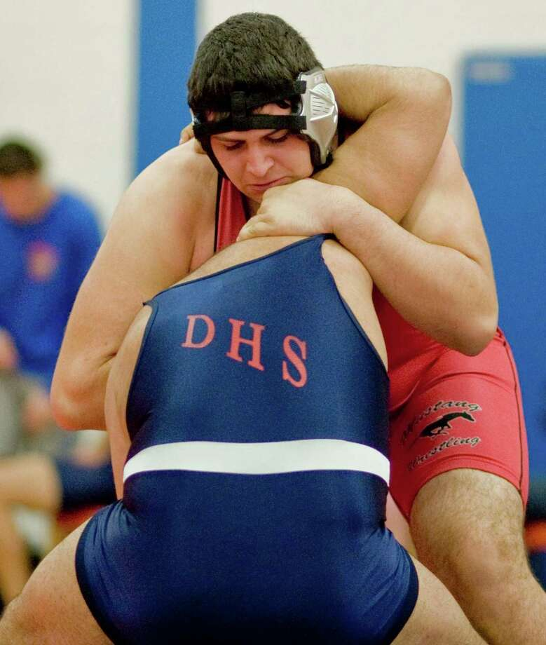 Fairfield Warde High School's Ahmed Hourani is one of three Fairfield wrestlers to qualify for this weekend's New England wrestling championships in Providence, R.I. Photo: Scott Mullin / The News-Times Freelance