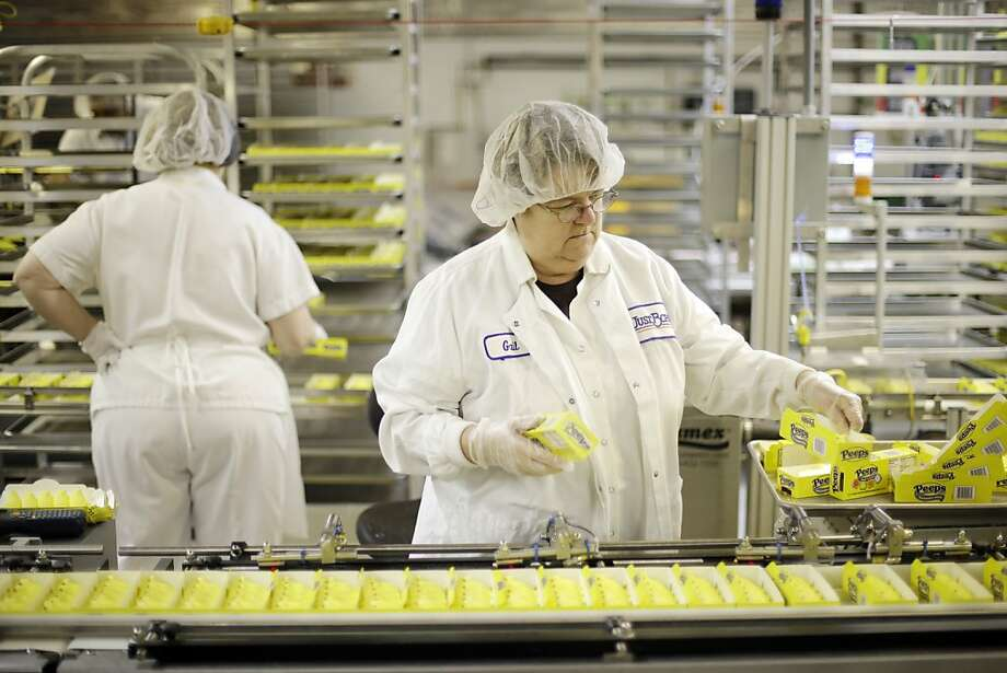 Gail Counterman works with Peeps as they move through the manufacturing process at the Just Born factory Wednesday, Feb. 13, 2013, in Bethlehem, Pa. (AP Photo/Matt Rourke) Photo: Matt Rourke, Associated Press