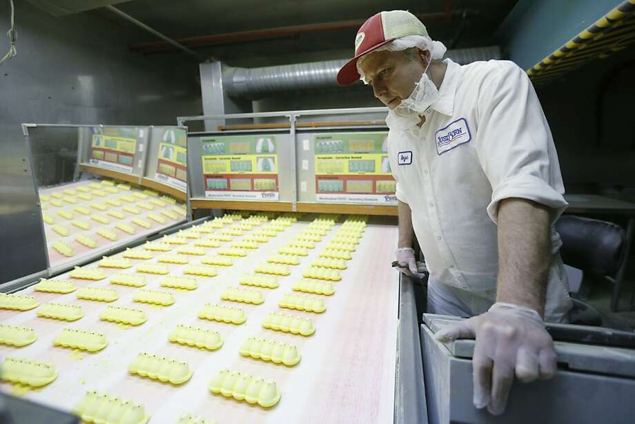 Roger Hildebeitel inspects Peeps as they move through the manufacturing process at the Just Born factory Wednesday, Feb. 13, 2013, in Bethlehem, Pa. (AP Photo/Matt Rourke) Photo: Matt Rourke, Associated Press