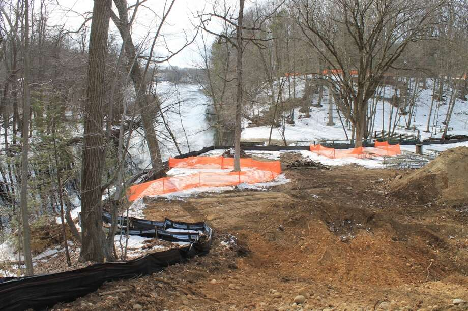 A look from the high ground near the Merritt Parkway down toward the Saugatuck River and Lees Pond. Note the double-layer erosion/silt barrier and trees marked for protection.