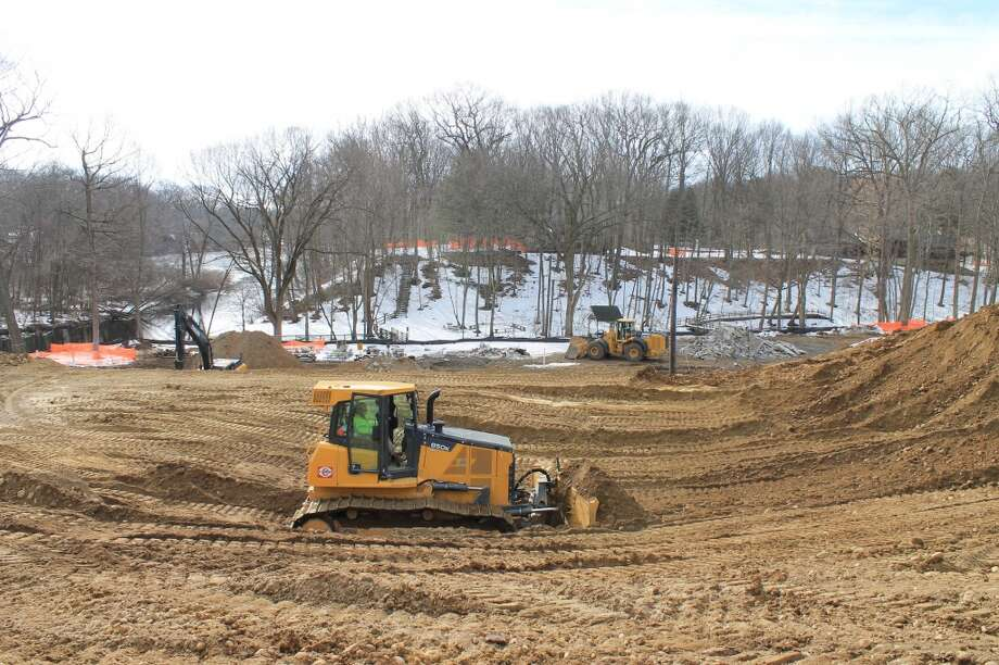 Bulldozers grade the area where the foundation for the new Y will be dug.
