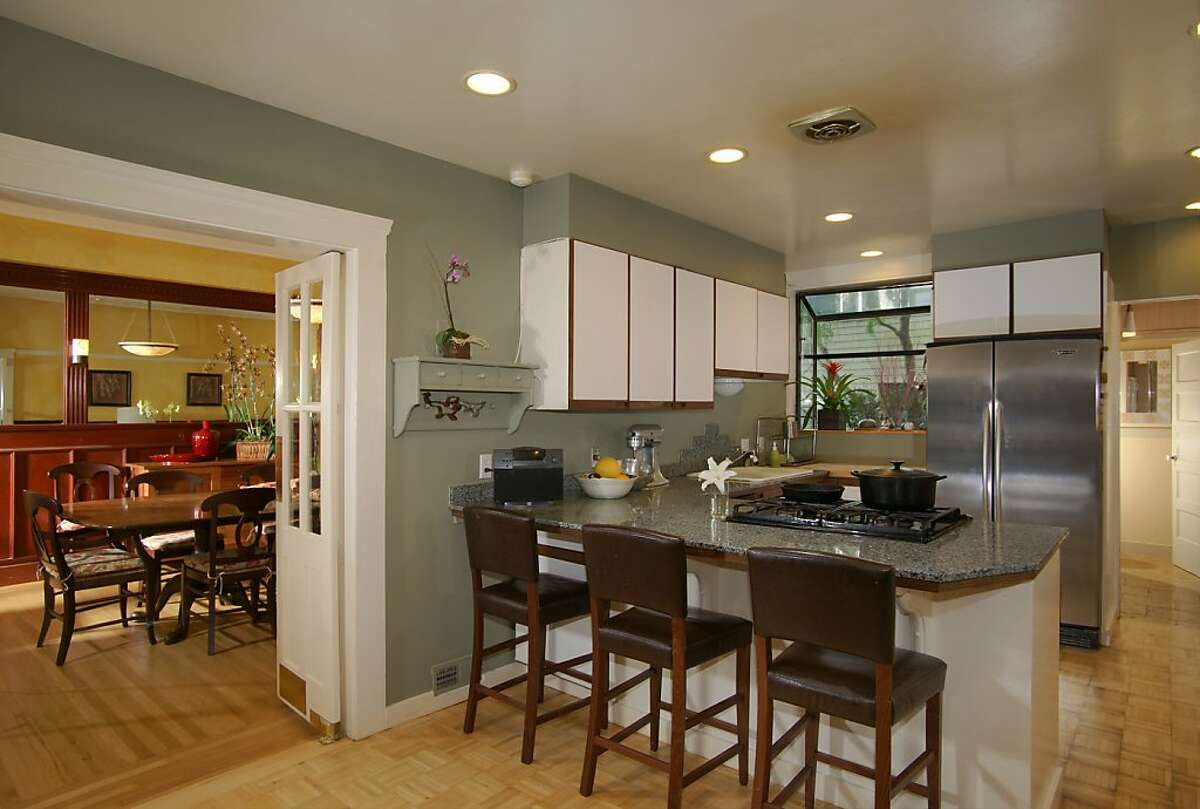 The kitchen has a breakfast bar and butcher block.