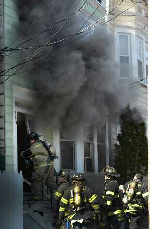 Albany firefighters arrive to attack the fire at 268 Sheridan Avenue Feb. 26, 2013 in Albany, N.Y.  (Skip Dickstein/Times Union) Photo: SKIP DICKSTEIN