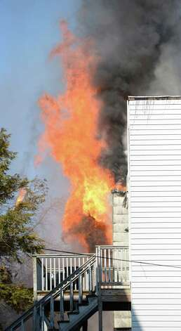 Fire billows from the rear of 268 Sheridan Avenue Feb. 26, 2013 in Albany, N.Y.  (Skip Dickstein/Times Union) Photo: SKIP DICKSTEIN