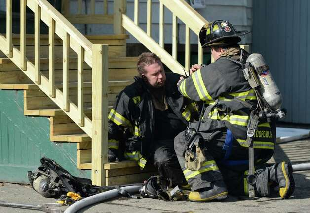 An Albany firefighter who was overcome with smoke is attended to at the fire at 268 Sheridan Avenue Feb. 26, 2013 in Albany, N.Y.  (Skip Dickstein/Times Union) Photo: SKIP DICKSTEIN