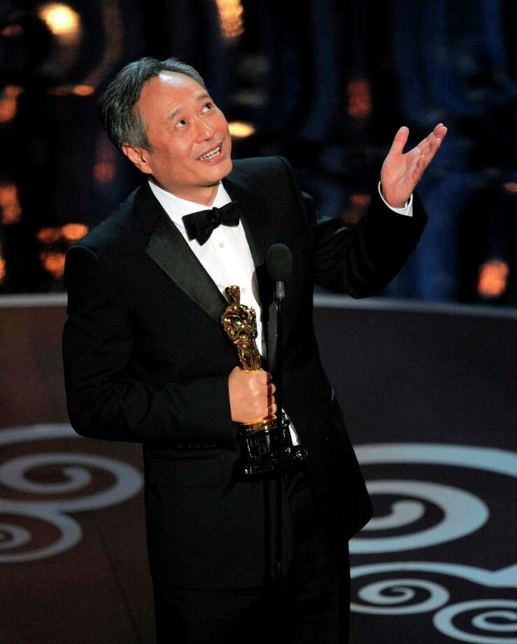 Ang Lee accepts the award for best directing for Life of Pi during the Oscars at the Dolby Theatre on Sunday, Feb. 24, 2013, in Los Angeles.  (Photo by Chris Pizzello/Invision/AP) Photo: Chris Pizzello, Associated Press / Invision