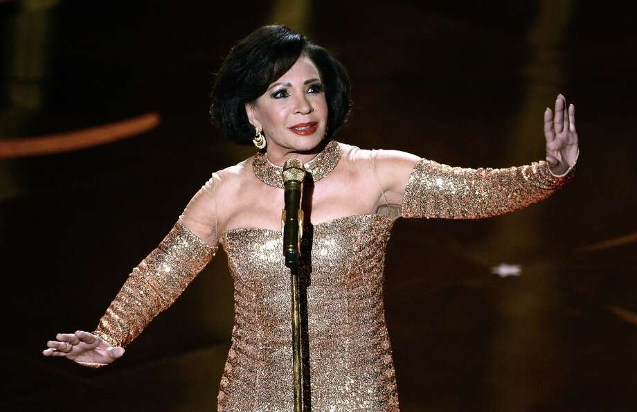 Singer Shirley Bassey performs onstage during the Bond tribute at the Oscars held at the Dolby Theatre on February 24, 2013 in Hollywood, California. Photo: Kevin Winter, Getty Images / 2013 Getty Images