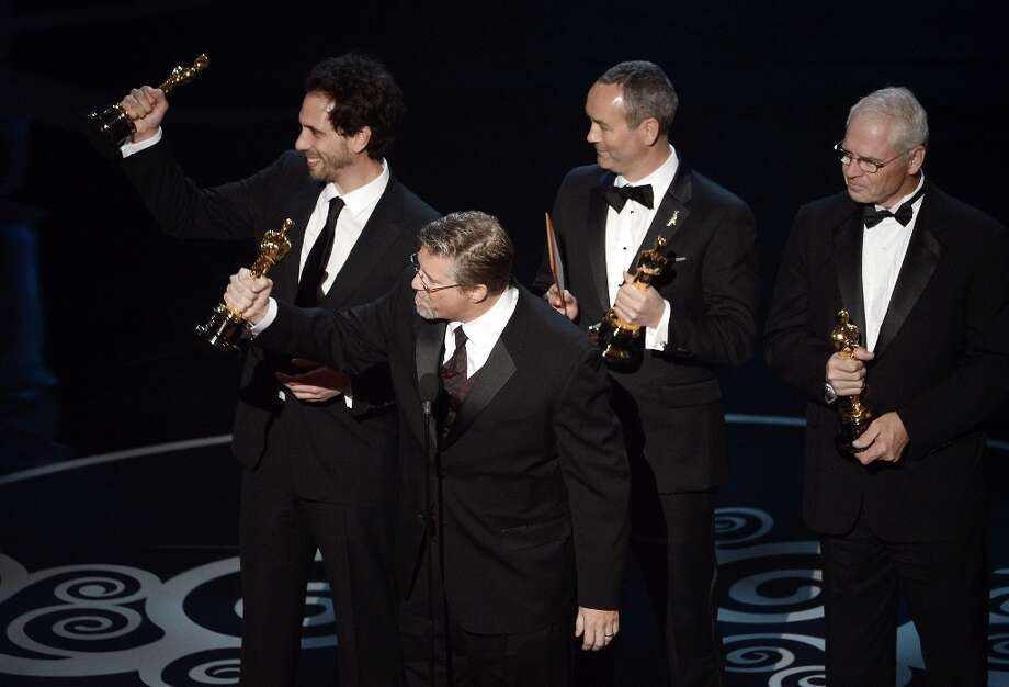 VFX supervisors Guillaume Rocheron, Bill Westenhofer, Erik-Jan De Boer and Donald R. Elliott accept the Best Visual Effects award for Life of Pi onstage during the Oscars held at the Dolby Theatre on February 24, 2013 in Hollywood, California. Photo: Kevin Winter, Getty Images / 2013 Getty Images