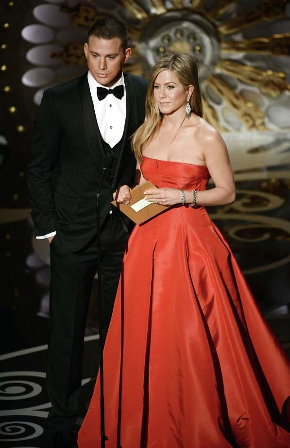Actor Channing Tatum and actress Jennifer Aniston present onstage during the Oscars held at the Dolby Theatre on February 24, 2013 in Hollywood, California. Photo: Kevin Winter, Getty Images / 2013 Getty Images