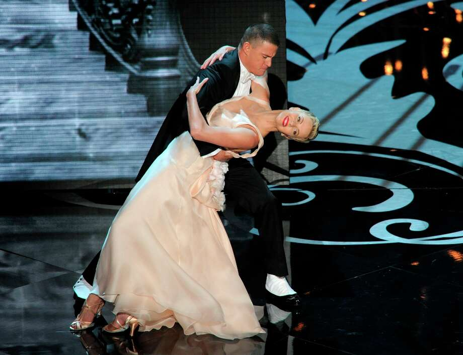 Channing Tatum, left, and Charlize Theron perform during the Oscars at the Dolby Theatre on Sunday Feb. 24, 2013, in Los Angeles.  (Photo by Chris Pizzello/Invision/AP) Photo: Chris Pizzello, Associated Press / Invision