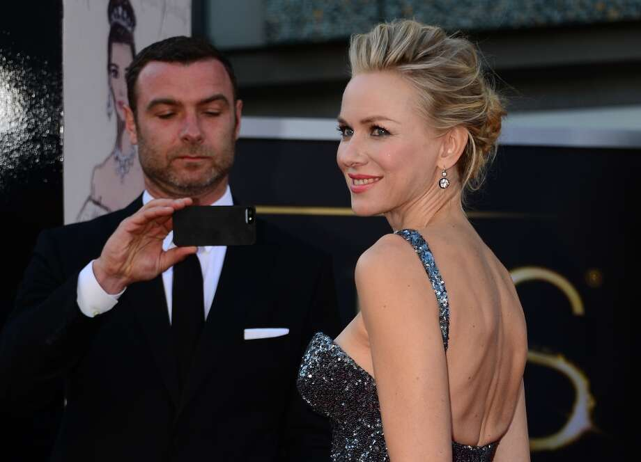 Actor Liev Schreiber takes photos of the best Actress nominee Naomi Watts as she arrives on the red carpet for the 85th Annual Academy Awards on February 24, 2013 in Hollywood, California. AFP PHOTO/FREDERIC J. BROWN Photo: FREDERIC J. BROWN, AFP/Getty Images / AFP