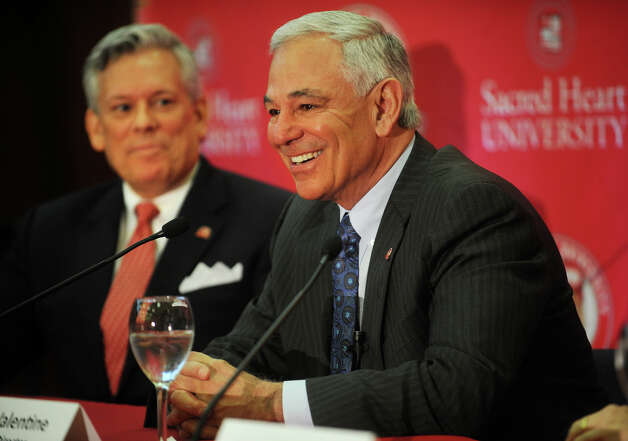 Bobby Valentine smiles following his  introduction as the new executive director of intercollegiate athletics at Sacred Heart University in Fairfield on Tuesday, February 26, 2013. At left is James Barquinero, senior vice president of athletics and student affairs. Photo: Brian A. Pounds / Connecticut Post