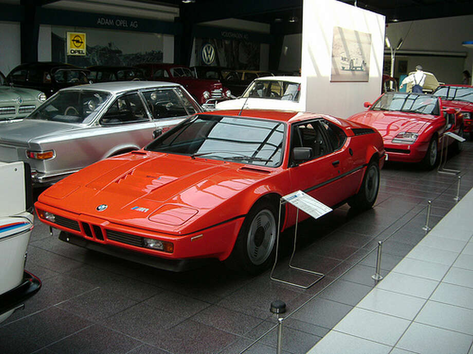 77. BMW M1 (1978–1981) What Popular Mechanics said: The first BMW to wear the now-famous M badge, the M1 is one of the rarest BMW models. Its midengine layout was designed specifically for racing success.(Photo: Sporthotel Achental, Flickr)Source: Popular Mechanics Photo: Flickr