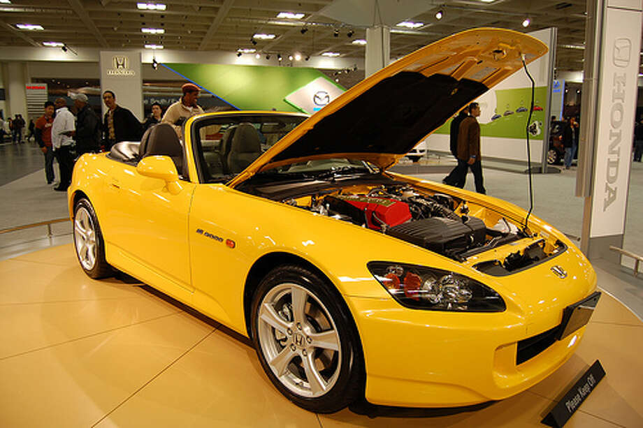 76. Honda S2000 (1999–2009) What Popular Mechanics said: With tremendous handling, attractively chiseled lines and a howling 9000-rpm engine sending chills down spines, the S2000 was the ultimate expression of turn-of-the-century Honda tech. (Photo: Tekniks, Flickr)Source: Popular Mechanics Photo: Flickr