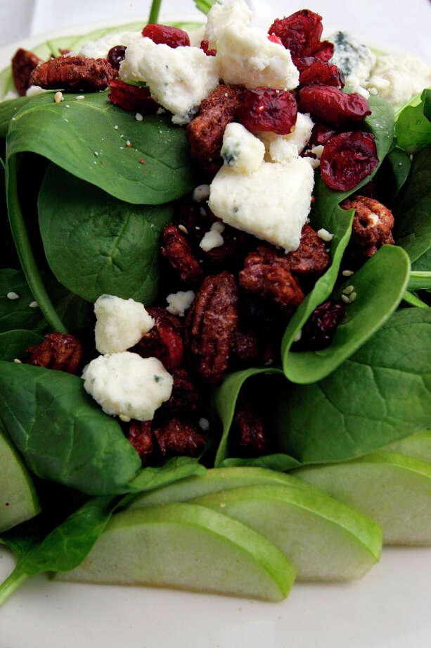 Green Vegetarian Cuisine has a Spinach Salad plate. Photo: KEVIN GEIL, SAN ANTONIO EXPRESS-NEWS / SAN ANTONIO EXPRESS-NEWS