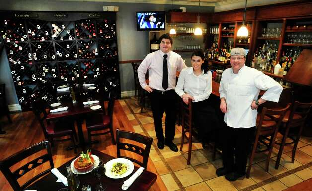 Owner Fabio Morrone, left center, Kerry McCarthy, and chef  Michael Pedicini, right, are at Luca, in Georgetown Thursday, Feb. 7, 2012. Photo: Michael Duffy / The News-Times