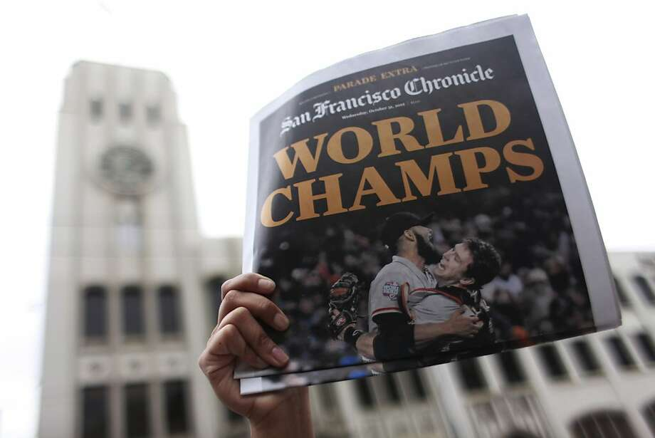 San Francisco Chronicle extras are sold during the parade honoring the San Francisco Giants World Series win on Wednesday Oct. 28, 2012 in San Francisco, Calif. Photo: Mike Kepka, The Chronicle