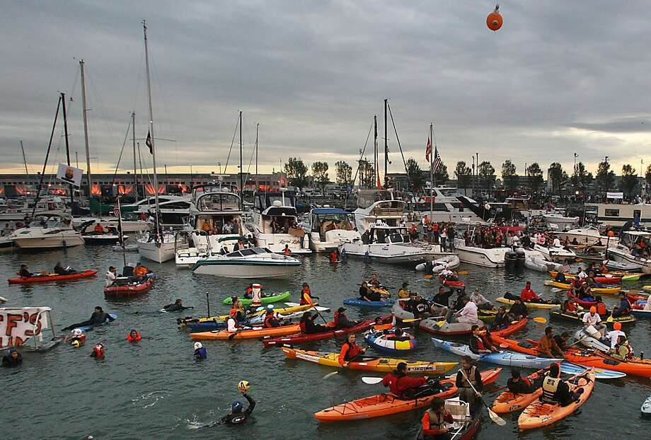 A familiar site in McCovey Cove: boats, kayaks and folks brave or dumb enough to jump in the water. Photo: Liz Hafalia, The Chronicle
