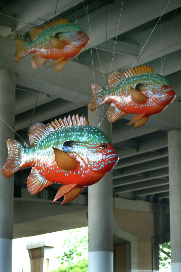 Donald Lipski's 7-foot long longear sunfish under the Interstate 35 underpass on the Museum Reach section of the River Walk. Photo: JENNIFER LLOYD, 210SA / 210SA