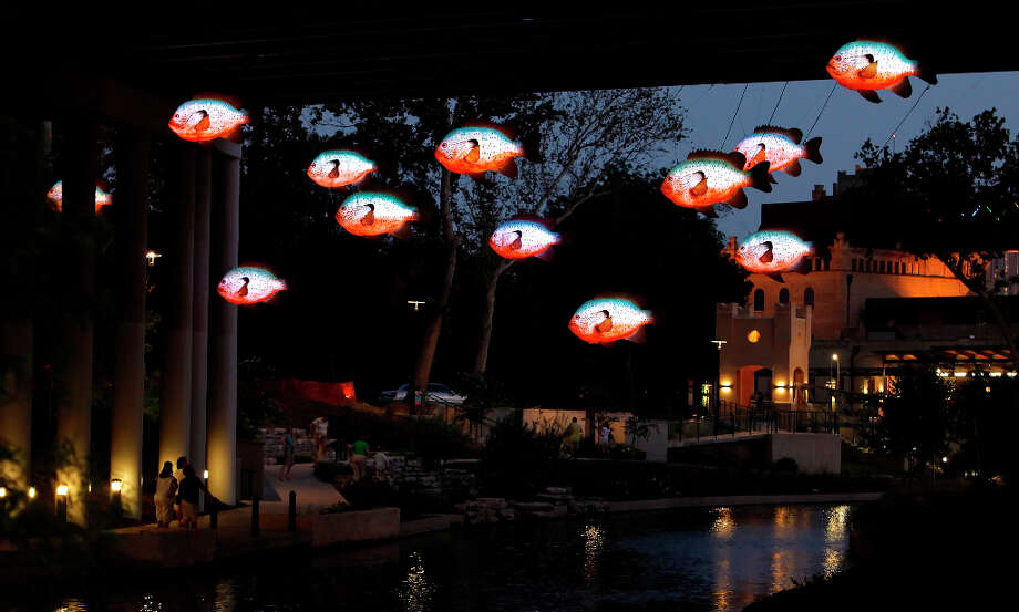 Image of the San Antonio River Museum Reach area on Friday, July 10, 2009. Artist Donald Lipski's sunfish sculptures are seen lit as pedestrians stroll along the river's path. The San Antonio Museum can also be seen just past the sunfish sculptures. Kin Man Hui/kmhui@express-news.net Photo: KIN MAN HUI, San Antonio Express-News / kmhui@express-news.net