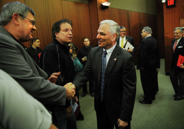 Men's basketball Coach Dave Bike, left, shakes hands with Bobby Valentine following Valentine's introduction as the new executive director of intercollegiate athletics at Sacred Heart University in Fairfield on Tuesday, February 26, 2013. Photo: Brian A. Pounds / Connecticut Post