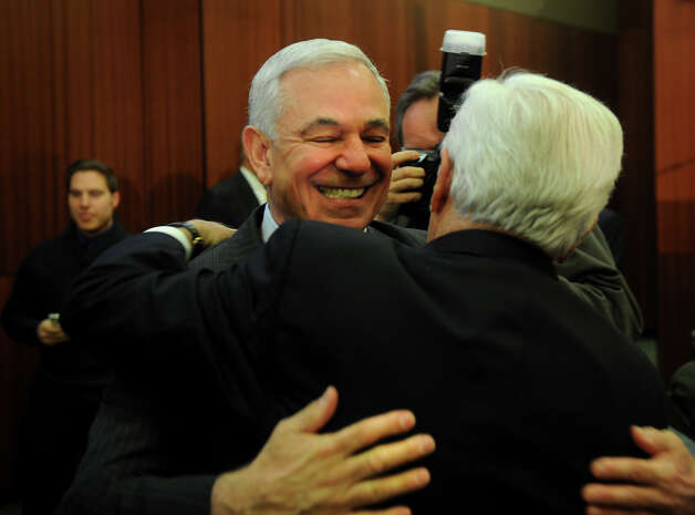Bobby Valentine, left, hugs Donk Cook, the man he is replacing as executive director of intercollegiate athletics at Sacred Heart University in Fairfield on Tuesday, February 26, 2013. Photo: Brian A. Pounds / Connecticut Post