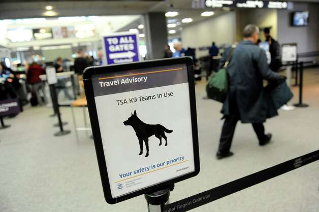 A sign alerts passengers that Passenger Screening Canines are at work on Tuesday, Feb. 26, 2013, at Albany International Airport in Colonie, N.Y. The dogs are trained to detect possible explosive substances for the Transportation Security Administration. (Cindy Schultz / Times Union) Photo: Cindy Schultz / 00021287A