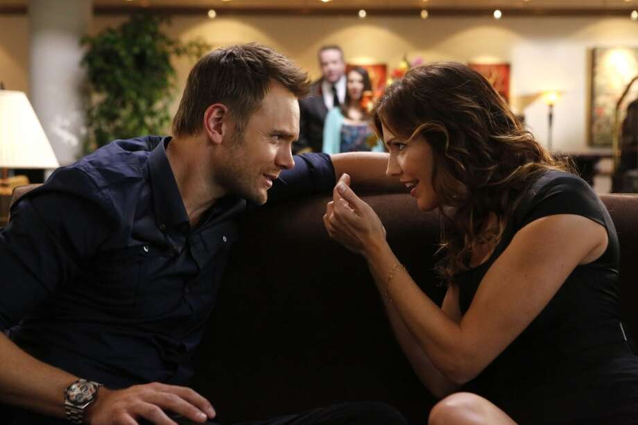 In 2012, Tricia Helfer appeared on the show ''Community'' with Joel McHale (L).