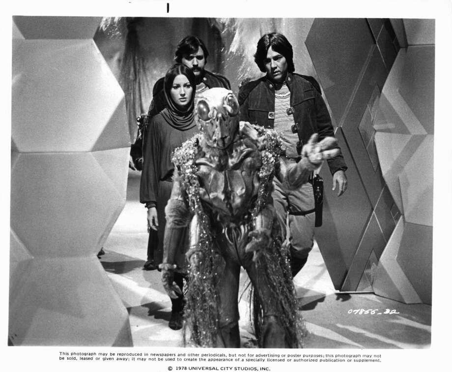 ''Battlestar's'' unearthly creatures also looked better in the remade show than in the 1978 original, pictured. Here's actors Jane Seymour, Tony Swartz (center) and Richard Hatch with an alien.