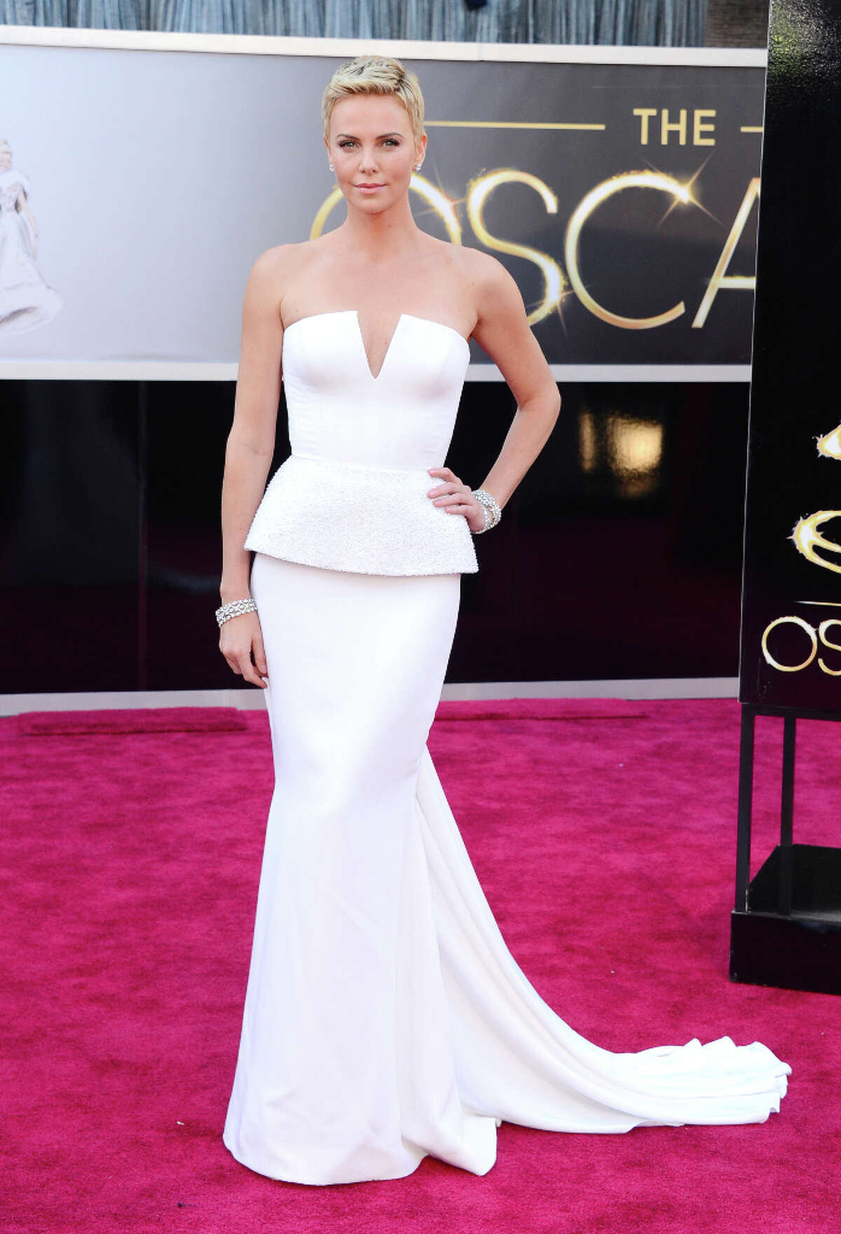 10. CHRISTIAN DIOR: $100,000 Charlize Theron wore this couture Dior gown for the 2013 Oscars. With the jewelry included, the entire look reached a total of more than $4 million, according to Getty Images.