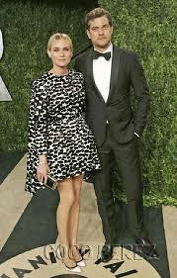 Diane Kruger in Giambattista Valli, left, and Joshua Jackson (Photo Getty Images)