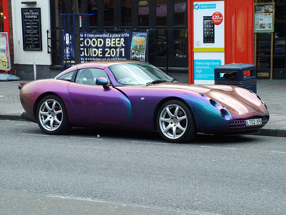 67. TVR Tuscan (1999–2006) What Popular Mechanics said: With its spidery eyes, classic British shape, and roaring Speed Six engine, the modern iteration of the TVR Tuscan is like nothing else on the road. (Photo: Kenjonbro, Flickr)Source: Popular Mechanics Photo: Flickr