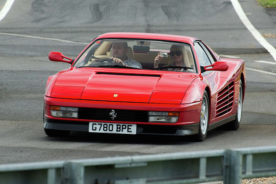 65. Ferrari Testarossa (1984–1996)What Popular Mechanics said:Ask a layman to picture a Ferrari and the Testarossa is likely what comes to mind. The boxer 12-cylinder engine and unmistakable appearance make the Testarossa still the definitive Ferrari.(Photo: Furlined, Flickr)Source: Popular Mechanics Photo: Flickr