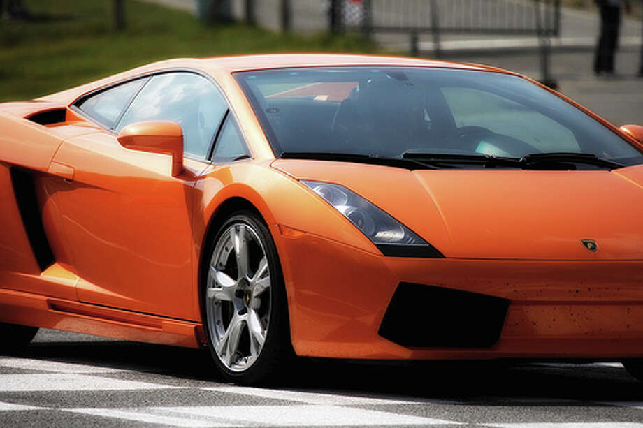 "61. Lamborghini Gallardo (2003–Present) What Popular Mechanics said: In 2003, Lamborghini welcomed a second model into its stable, the ""entry-level"" Gallardo. Designed to do battle with the midengined Ferraris, it offered a strikingly distinct style and an exhilarating high-rpm V-10 engine. (Photo: Lwoodfp, Flickr)Source: Popular Mechanics Photo: Desbois Laurent, Flickr / Laurent Desbois"