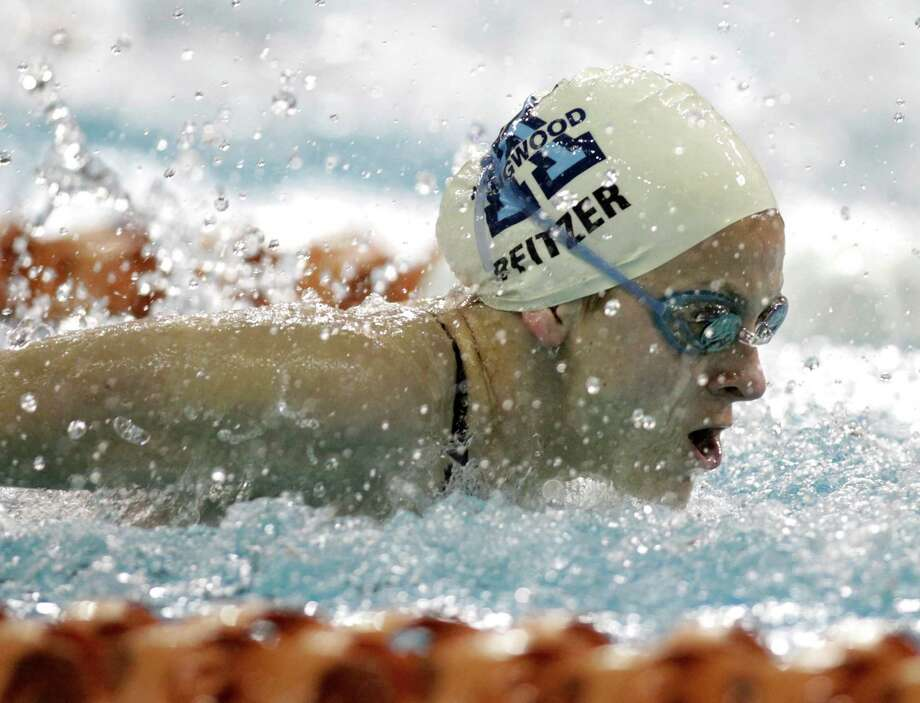 Kingwood's Leah Pfitzer swims in the girls 100-yard butterfly during the prelims of the state swimming championships in Austin. Photo: Erich Schlegel / ©2013 Erich Schlegel