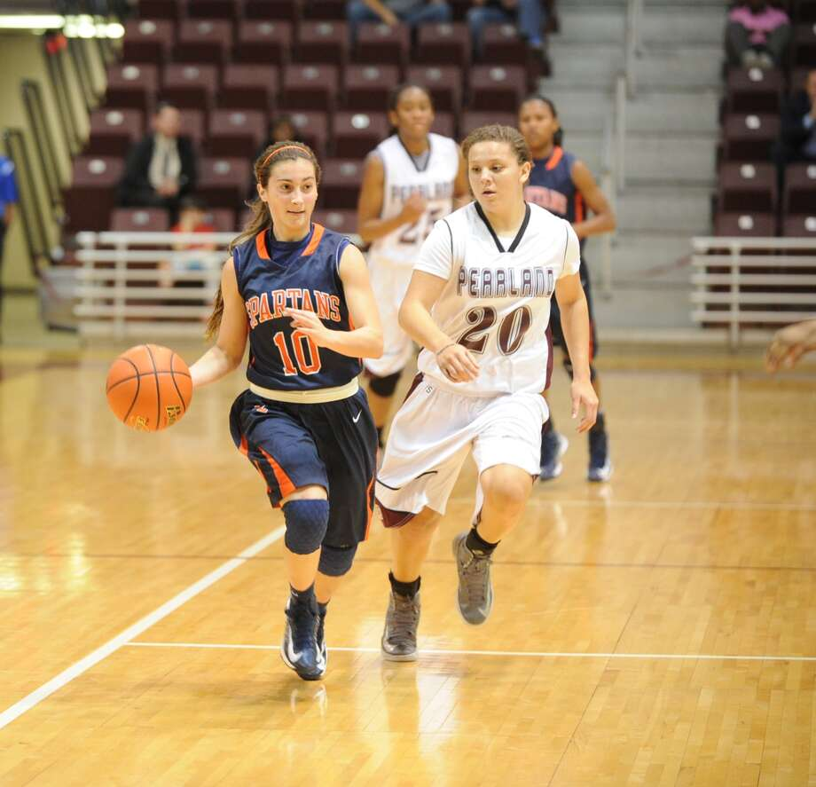 Seven Lakes junior point guard Ally Barrios (10), lead a fast break against Pearland's Miranda Lejune (20) in the 5A Region III tournament. Barrios will be the only returning starter from this season's squad. Photo: Eddy Matchette, Freelance / Freelance
