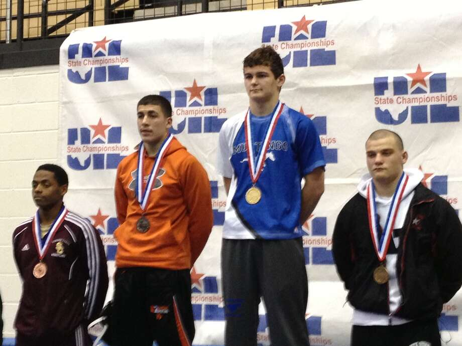 UIL stste wrestling championsBrad Rains (in blue), Friendswood (170-pound class)Not pictured:William Homalon, Morton Ranch and Johnny Nguyen, Foster Photo: Scott Hainline