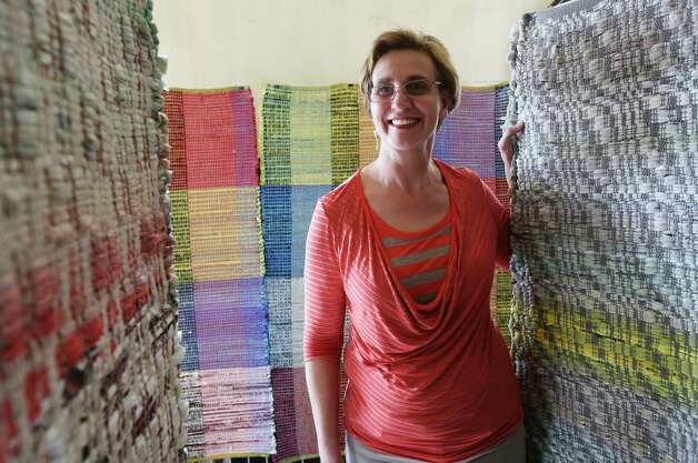 Artist Doerte Weber has woven together tapestries made of recycled newspaper bags. Photo: Helen L. Montoya, San Antonio Express-News / ©2013 San Antonio Express-News