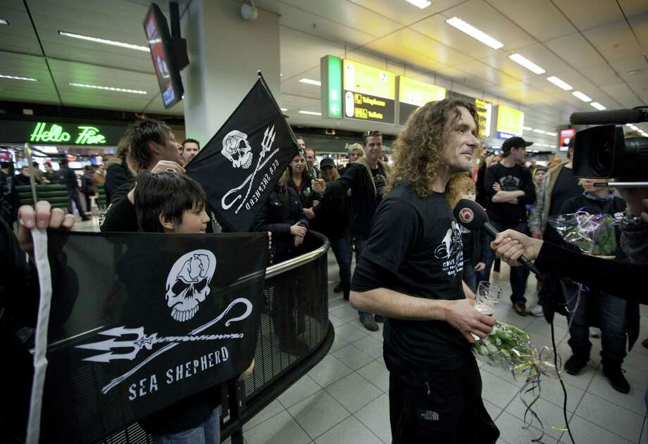 Released Dutch Sea Shepherd activist Erwin Vermeulen speaks to the press as he is greeted at the airport in Schiphol on February 25, 2012 on his way back from Japan where his was held for two months on assault charges following a clash with dolphin hunters. Erwin Vermeulen was put on remand in Taiji for allegedly punching a man in December as he was stopped from entering an off-limits area near a secluded bay where the hunts take place. Photo: PHIL NIJHUIS, Getty Images / 2012 AFP