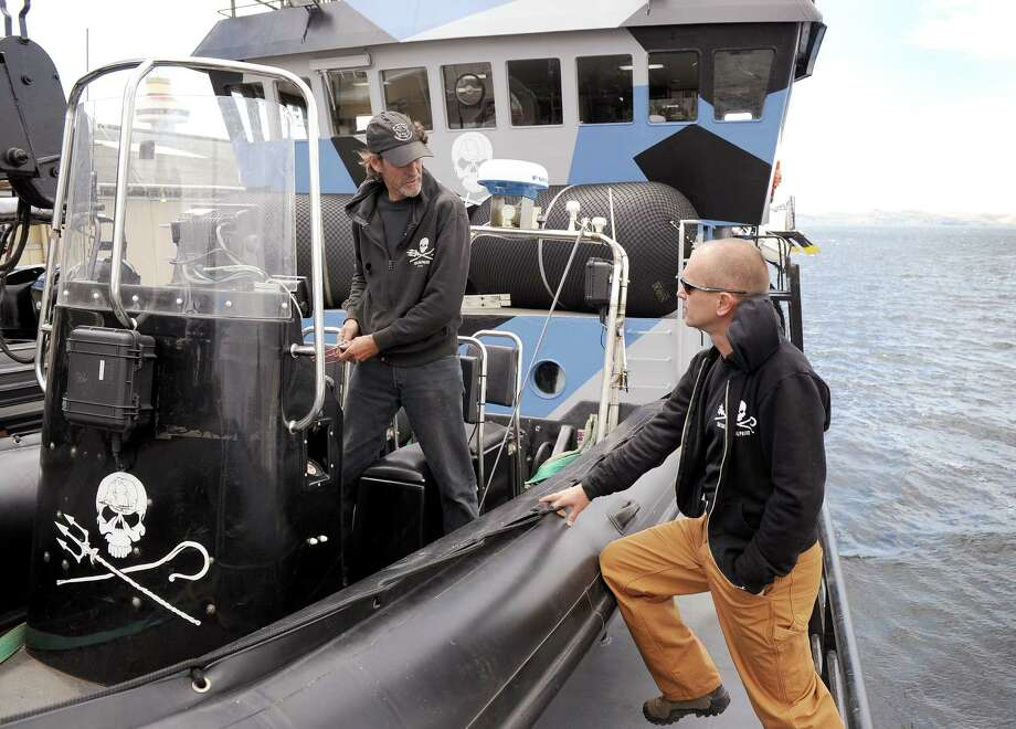 Alex Cornelissen (R), captain of the militant environmentalist group Sea Shepherd ship 'Bob Barker', talks to boat driver Philip Peterson (L) while moored in Hobart as they prepare to leave to confront the Japanese whaling fleet in the Southern Ocean on Dec. 13, 2011.  Sea Shepherd are sending a flotilla of three vessels crewed by 88 people from 25 different nationalities in an attempt to prevent the whale hunt. Photo: WILLIAM WEST, Getty Images / 2011 AFP