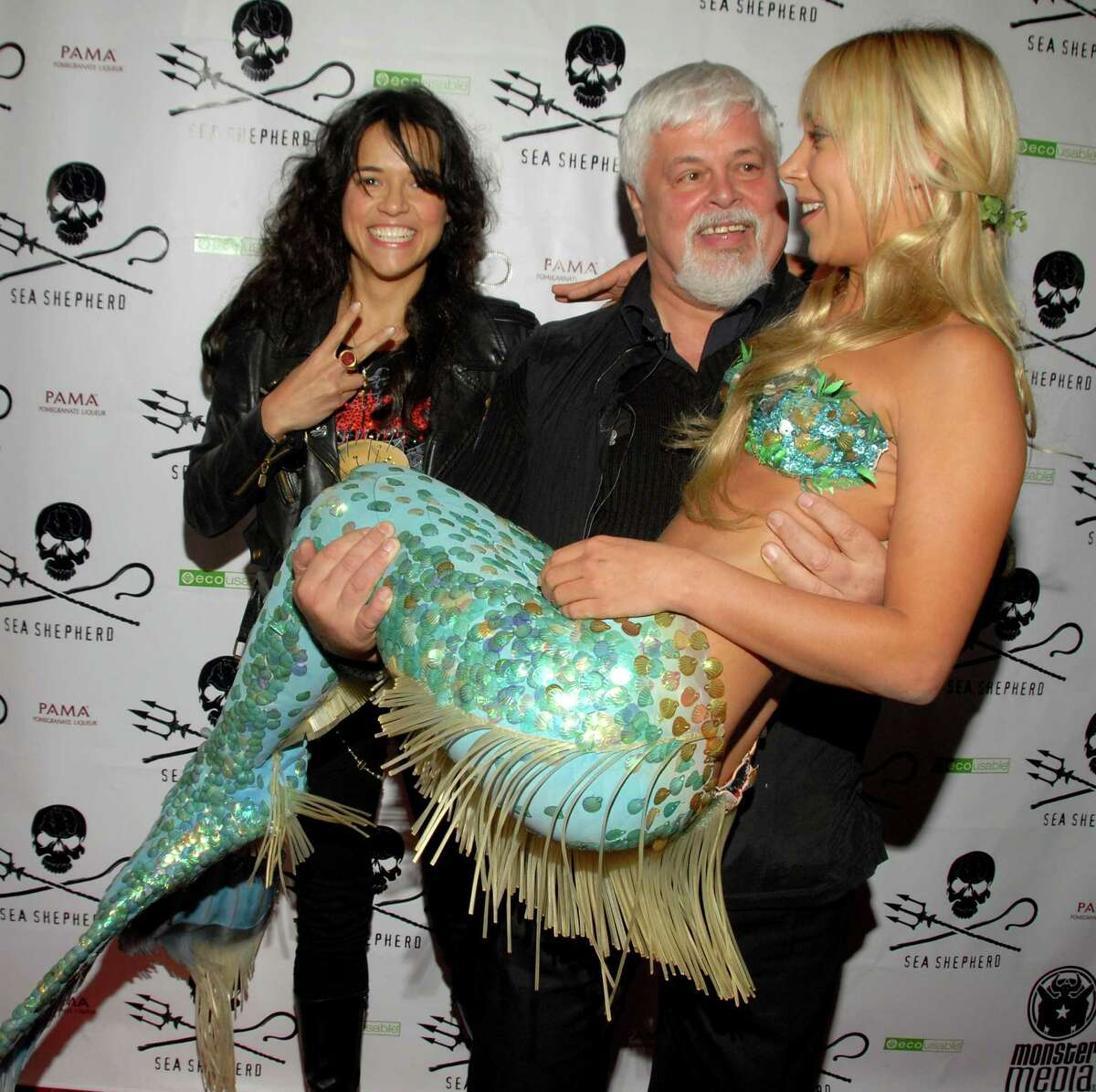 Actress Michelle Rodriguez, activist Paul Watson and a mermaid attend Animal Planet & Sea Shepherd Conservation Society event on October 23, 2010 in Los Angeles. (Photo by Mark Sullivan/WireImage)