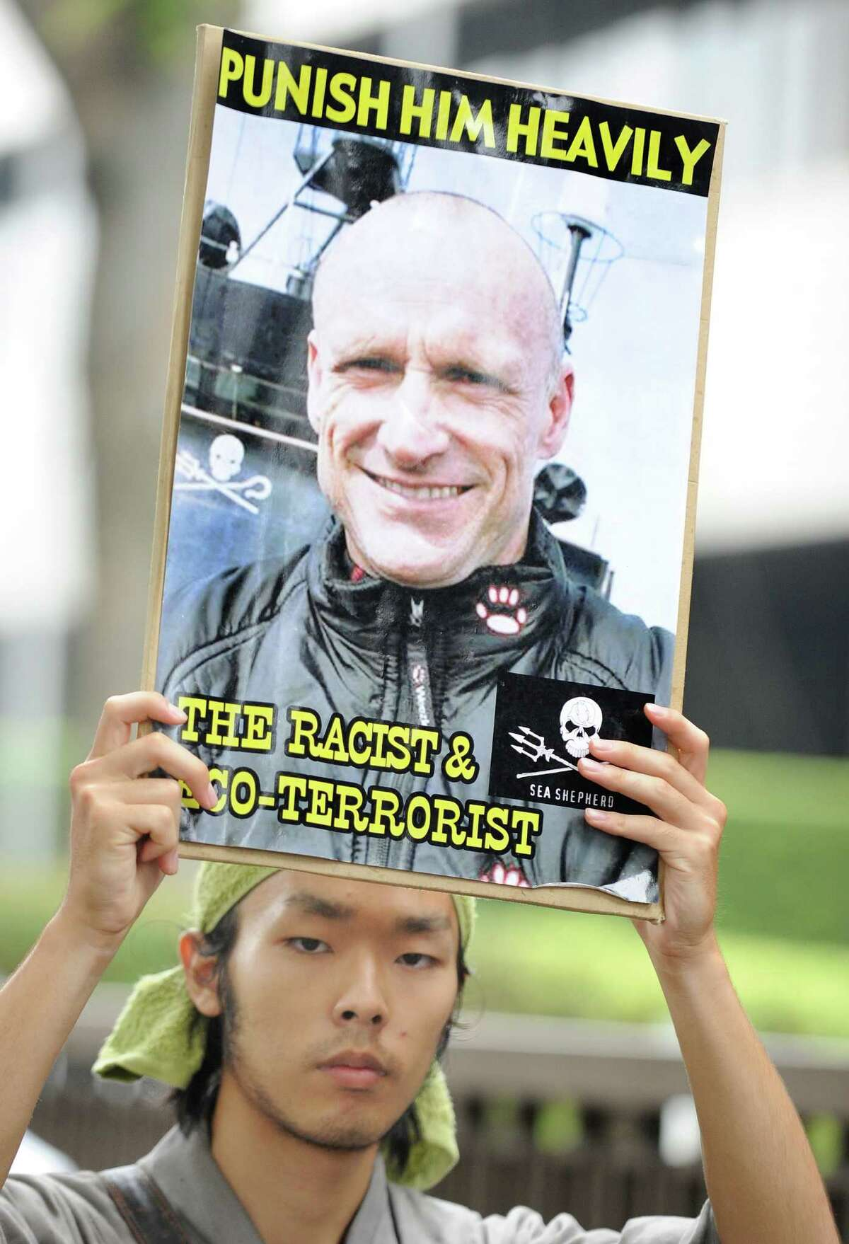 A Japanese activist holds a portrait denouncing New Zealand anti-whaling activist Peter Bethune of the US-based Sea Shepherd Conservation Society during his trial in front of the Tokyo District Court in Tokyo on July 7, 2010. Meanwhile the activist was handed a suspended two-year prison term in Japan for offences relating to clashes with Japanese whalers in Antarctic waters.
