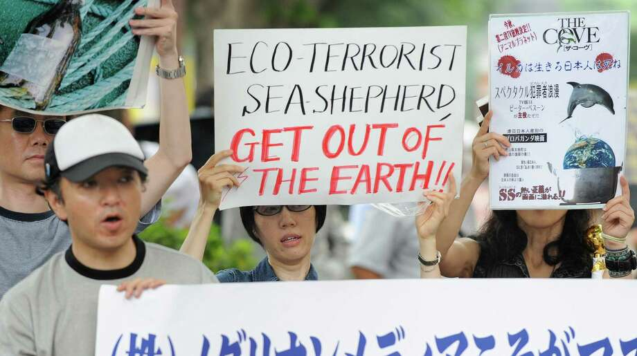 Japanese activists hold banners denouncing New Zealand anti-whaling activist  Peter Bethune of the US-based Sea Shepherd Conservation Society during his trial in front of the Tokyo District Court in Tokyo on July 7, 2010. Meanwhile the activist was handed a suspended two-year prison term in Japan for offences relating to clashes with Japanese whalers in Antarctic waters. Photo: TORU YAMANAKA, Getty Images / 2010 AFP