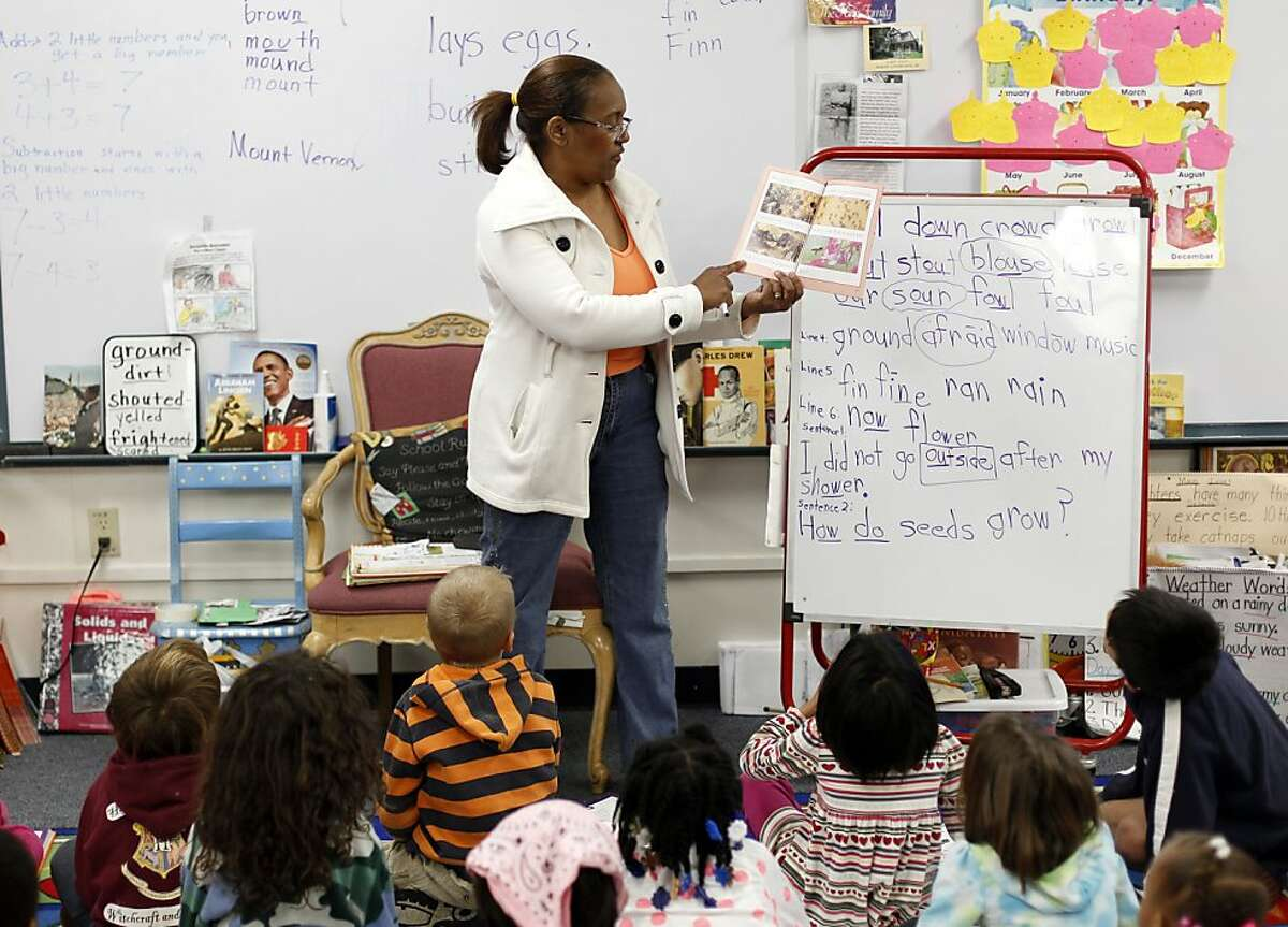 First grade teacher Linda Thomas reads aloud to her class at Peralta Elementary on Tuesday, Tuesday February 26, 20123 in Oakland, Calif.
