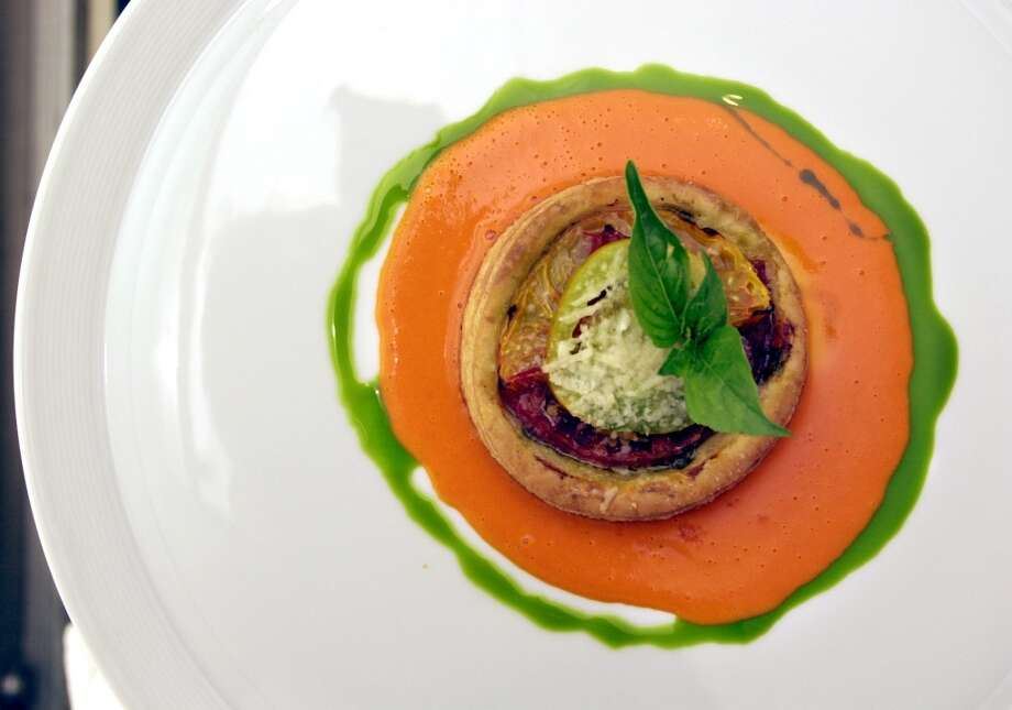 2002: Heirloom Tomato Tartlet with pesto roasted tomato sauce and basil oil prepared at Masa's.