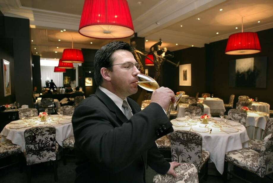 2002: Super sommelier Alan Murray of Masa's trying some sparkling wine in the dining room.