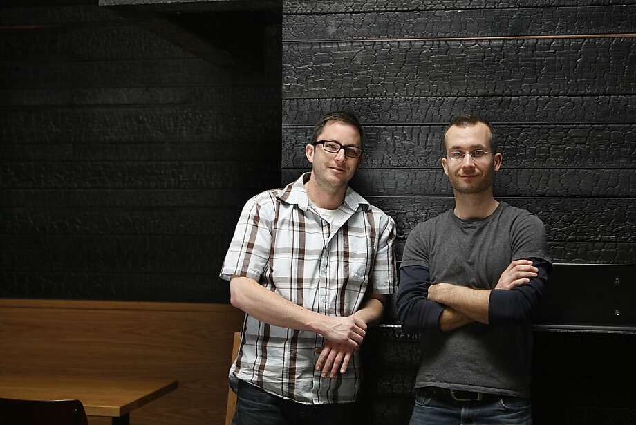 Zarin Gollogly (left) and Spencer Lafrenz of Harrison Woodworking + Design made the custom-scorched walls for Hi Lo BBQ in San Francisco. Photo: Liz Hafalia, The Chronicle