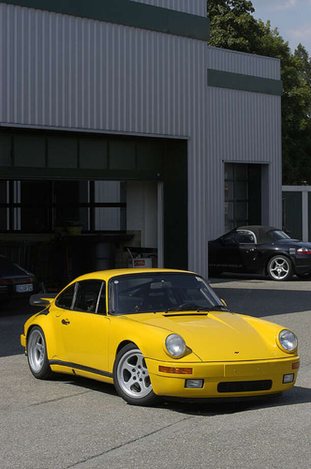 "46. RUF CTR ""Yellow Bird"" (1987) What Popular Mechanics said: This car, essentially a heavily modified Porsche 911, inspired many young car lovers when it appeared in the 1980s. (Photo: Ducktail964, Flickr)Source: Popular Mechanics Photo: Flickr"